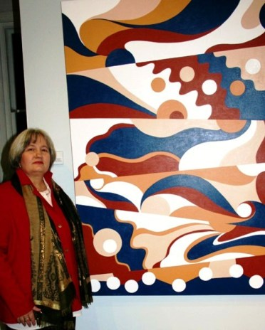 Karen Robinson - Abstract Artist standing alongside of Painting No. 23 Titled 'Related Families' at an Exhibition called 'Ways Out - Journeys through Recovery' at Synergy Gallery, Northcote, Melbourne Aust. 2009 NB: All images are protected by copyright laws.jpg