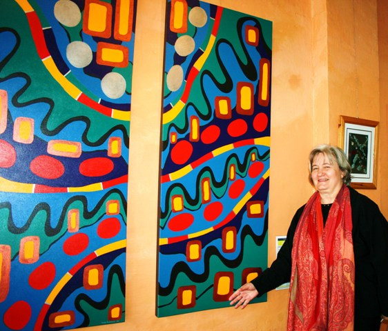 Karen Robinson - Abstract Artist standing alongside of Paintings No. 26A and 26B Titled 'Green Peace & Human Nature Exhibition called 'Ways Out - Journeys through Recovery' at Synergy Gallery, Northcote, Melbourne Aust. 2009 NB: All images are protected by copyright laws.JPG