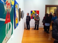 Karen Robinson - Abstract Artist with Hubby standing along side of Painting No. 45E Titled 'Reaching Out to Sons' TAC's 'Picture This' Exhibition 2011 at Geelong Gallery NB All images are protected by copyright..JPG