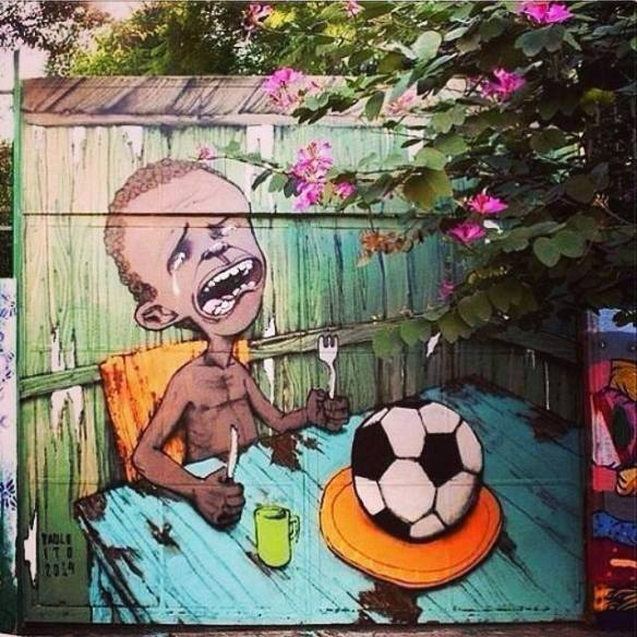 Paulo Ito - Brazilian Graffiti Street Artist Mural Ref: Mosbergen. D. (May 21 2014). The Huffington Post. Street Artist Captures The Sheer Irony of Brazil's World Cup in Heartbreaking Image. [Photograph ID: Paulo Ito Mural]. Retrieved 5th May 2014 from http://www.huffingtonpost.com/2014/05/21/brazil-world-cup-poverty-paulo-ito_n_5362373.html?utm_hp_ref=arts&ncid=fcbklnkushpmg00000027