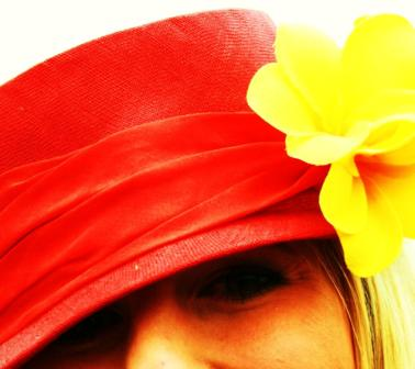 A young racegoer in a fabulous red hat with a yellow flower at 'Derby Day' Flemington Racecourse 2008 Melbourne, Australia. Photo taken by Karen Robinson - Abstract Artist NB All images