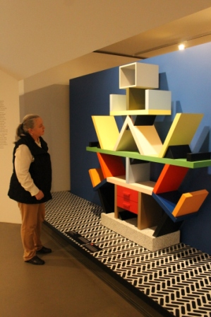 Karen Robinson standing next to 'Ettore Sottasass Memphis, Milan Carlton room divider 1981' at National Gallery of Victoria's 'Art as Therapy' Works July 2014 NB: All images are protected by copyright laws!