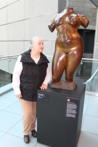 Karen Robinson standing next to 'Gaston Lachaise Torsoc.1912-27.cast 1937' at National Gallery of Victoria's 'Art as Therapy' Works July 2014 NB: All images are protected by copyright laws!