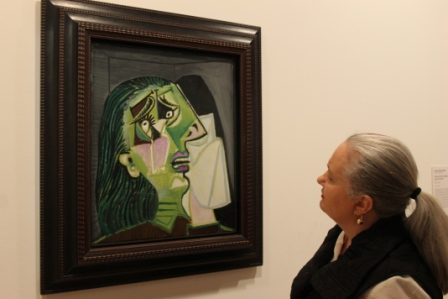 Karen Robinson standing next to 'Pablo Picasso Weeping woman 1937' at National Gallery of Victoria's 'Art as Therapy' Works July 2014 NB: All images are protected by copyright laws!