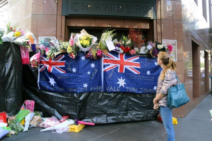 Photo taken by ABC News: Kylie Williams of two Australian flags form part of a public tribute to the two hostages killed at the Lindt Cafe in Martin Place, Sydney Australia Retrieved 19/12/2014 from http://www.abc.net.au/news/2014-12-17/sydney-siege-flower-and-tributes-overflow-in-martin-place/5972412