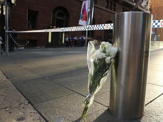 Picture by John Grainger. The first of the floral tributes stands alone at Martin Place at 5.45am -The Daily Telegraph 17/12/2014. Retrieved 19/12/2014 from http://www.dailytelegraph.com.au/news/nsw/sydney-siege-amazing-scenes-as-sydneysiders-empty-florists-to-fill-martin-place-with-flowers/story-fni0cx12-1227157698015?nk=bb450278d46e93b005c405fcba30b6f4