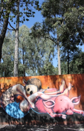Photo No. 5 of 21 'KAFF-EINE' Street Artist Work - Melbourne Street Art Fitzroy at Smith Reserve on Alexander Parade - Just one of the amazing wondrous creatures along the walls. I can image children being in awe of these images as they walk along the path leading into the play ground. There is a lovely connection being the human like creature and the animal which I like - Photographed by Karen Robinson.JPG