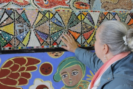 No. 6 of 70 images of MIRKA MORA'S FLINDERS ST STATION MURAL – Melbourne Australia Photographed by Karen Robinson 18th April 2015 - Karen looking at Mirka Mora's amazing mosaic art work
