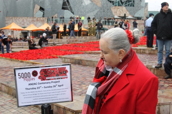 Photo No. 1 of 3 – 5000 Poppies Project Signage Federation Square, Melbourne, Australia featuring Karen Robinson – Abstract Artist photo taken by her husband 25.4.2015.JPG