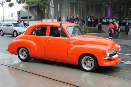 Photo No. 11 of 12 - Anzac Day March at Federation Square, Melbourne, Australia featuring Australia's first own car – its hood here blanketed with a sheath of poppies photo taken by Karen Robinson 25.4.2015.JPG