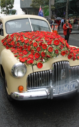 Photo No. 2 of 12 - Anzac Day March at Federation Square, Melbourne, Australia featuring Australia's first own car – its hood here blanketed with a sheath of poppies photo taken by Karen Robinson 25.4.2015.JPG