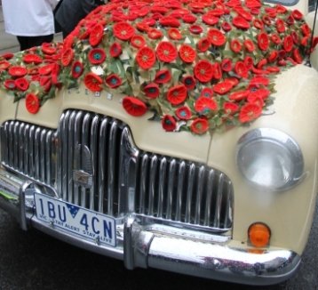 Photo No. 3 of 12 - Anzac Day March at Federation Square, Melbourne, Australia featuring Australia's first own car – its hood here blanketed with a sheath of poppies photo taken by Karen Robinson 25.4.2015.JPG
