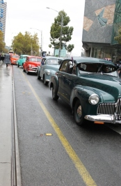 Photo No. 6 of 12 - Anzac Day March at Federation Square, Melbourne, Australia featuring Australia's first own car – its hood here blanketed with a sheath of poppies photo taken by Karen Robinson 25.4.2015.JPG