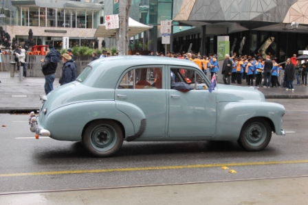 Photo No. 9 of 12 - Anzac Day March at Federation Square, Melbourne, Australia featuring Australia's first own car – its hood here blanketed with a sheath of poppies photo taken by Karen Robinson 25.4.2015.JPG