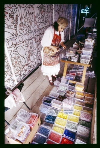 Mirka Mora cuts tiles for her mosaic at Flinders Station Melbourne - Australia 1986 in this photo by Rennie Ellis. Image from the State Library of Victoria Collection - Rennie Ellis Photographic Archive