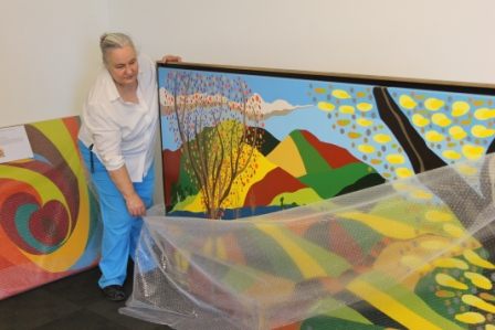 No. 16 - 'When words are hard to find' Solo Exhibition of Karen Robinson 6.5.15 Karen Robinson unwrapping bubble wrap at Gee Lee-Wik Doleen Gallery for Exhibition.JPG