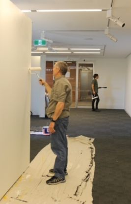 No. 18 - 'When words are hard to find' Solo Exhibition of Karen Robinson 6.5.15 Karen's husband helping at Gee Lee-Wik Doleen Gallery for Exhibition.JPG