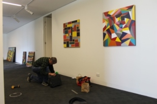 No. 19 - 'When words are hard to find' Solo Exhibition of Karen Robinson 6.5.15 Karen's husband helping at Gee Lee-Wik Doleen Gallery for Exhibition.JPG