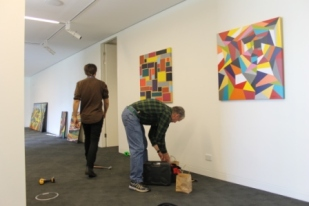 No. 20 - 'When words are hard to find' Solo Exhibition of Karen Robinson 6.5.15 Karen's husband helping at Gee Lee-Wik Doleen Gallery for Exhibition.JPG