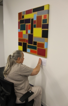 No. 24 - 'When words are hard to find' Solo Exhibition of Karen Robinson 6.5.15 Curator Tobias putting up wording at Gee Lee-Wik Doleen Gallery for Exhibition.JPG