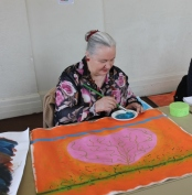 2 of 11 Art Therapy Session 31.8.2015 Karen Robinson - Abstract Artist painting on square canvas with acrylic paint being second stage in painting production for group project NB: All images are protected by copyright laws.JPG