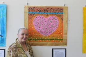 Karen Robinson - one of the carer group participants for 2015 at the Reflections Exhibition standing beside her painting tilted 'Heart of Treasured Memories' NB All images are protected by copyright laws