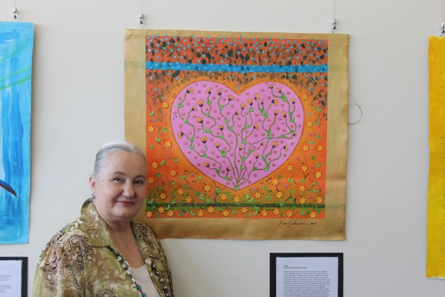 Photo featuring Karen Robinson - one of the carer group participants standing by her art work titled 'Heart of Treasured Memories'. Acrylic, Ink, Embroidered Flowers & Butterflies and Heart Sequins on Canvas. Event with the MIND Australia Organisation - Carer Group Exhibition, Northcote Townhall, Melbourne Australia 18th November 2015 NB: All images are protected by copyright laws!