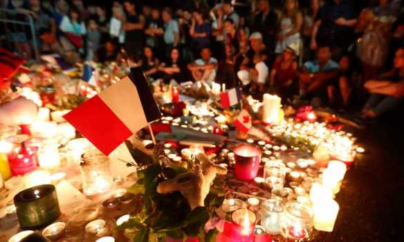 People gather in front of a memorial on the Promenade des Anglais, where the truck crashed into the crowd during the Bastille Day celebrations. Photograph: Ian Langsdon/EPA