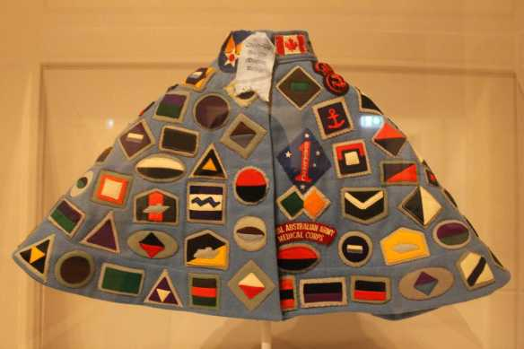 1 0f 2 'Golda Jean Ellis's Cheer Up Society Cape' exhibited at the 'Making the Australian Quilt - 1800-1950' Exhibition NGV Australia. Photographed by Karen Robinson. NB Images copyright protected