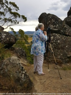 Karen took photos around and on Hanging Rock, Newham, Victoria - Australia. Accompanied by her husband on the day. Wonderful rock formations, natural Australian bush, native life and expansive scenic views from the top of Hanging Rock itself. NB: Karen's husband took this photo of her using a Samsung Galaxy S6 Mobile Phone - January 2017.