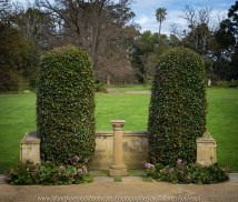 "Elsternwick, Victoria - Australia_Photographed by ©Karen Robinson_ www.idoartkarenrobinson.com September 10, 2017 Comments: My hubby and I with the Craigieburn Camera Club at Rippon Lea House and Gardens. ""It is one of Australia's finest grand suburban estates and the first to achieve National Heritage Listing, recognising its unique significance. The historic mansion is located within a vast pleasure garden of sweeping lawns that cover more than 14 acres and features a windmill, lookout tower, heritage orchard, lake, waterfall, fernery and more!"" Photograph featuring trimmed hedges and sundial."