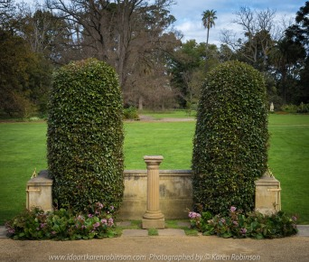 """Elsternwick, Victoria - Australia_Photographed by ©Karen Robinson_ www.idoartkarenrobinson.com September 10, 2017 Comments: My hubby and I with the Craigieburn Camera Club at Rippon Lea House and Gardens. """"It is one of Australia's finest grand suburban estates and the first to achieve National Heritage Listing, recognising its unique significance. The historic mansion is located within a vast pleasure garden of sweeping lawns that cover more than 14 acres and features a windmill, lookout tower, heritage orchard, lake, waterfall, fernery and more!"""" Photograph featuring trimmed hedges and sundial."""
