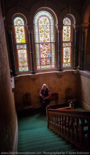 """Elsternwick, Victoria - Australia_Photographed by ©Karen Robinson_ www.idoartkarenrobinson.com September 10, 2017 Comments: My hubby and I with the Craigieburn Camera Club at Rippon Lea House and Gardens. """"It is one of Australia's finest grand suburban estates and the first to achieve National Heritage Listing, recognising its unique significance. The historic mansion is located within a vast pleasure garden of sweeping lawns that cover more than 14 acres and features a windmill, lookout tower, heritage orchard, lake, waterfall, fernery and more!"""" Photograph featuring Karen taking photos inside of the Mansion. Also featuring stained-glass windows."""
