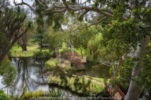 "Elsternwick, Victoria - Australia_Photographed by ©Karen Robinson_ www.idoartkarenrobinson.com September 10, 2017 Comments: My hubby and I with the Craigieburn Camera Club at Rippon Lea House and Gardens. ""It is one of Australia's finest grand suburban estates and the first to achieve National Heritage Listing, recognising its unique significance. The historic mansion is located within a vast pleasure garden of sweeping lawns that cover more than 14 acres and features a windmill, lookout tower, heritage orchard, lake, waterfall, fernery and more!"" Photograph featuring lake view from garden."