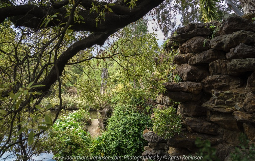 "Elsternwick, Victoria - Australia_Photographed by ©Karen Robinson_ www.idoartkarenrobinson.com September 10, 2017 Comments: My hubby and I with the Craigieburn Camera Club at Rippon Lea House and Gardens. ""It is one of Australia's finest grand suburban estates and the first to achieve National Heritage Listing, recognising its unique significance. The historic mansion is located within a vast pleasure garden of sweeping lawns that cover more than 14 acres and features a windmill, lookout tower, heritage orchard, lake, waterfall, fernery and more!"" Photograph featuring lake view and rock wall."