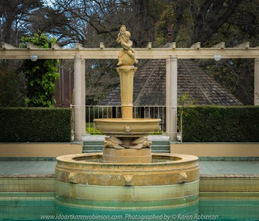 "Elsternwick, Victoria - Australia_Photographed by ©Karen Robinson_ www.idoartkarenrobinson.com September 10, 2017 Comments: My hubby and I with the Craigieburn Camera Club at Rippon Lea House and Gardens. ""It is one of Australia's finest grand suburban estates and the first to achieve National Heritage Listing, recognising its unique significance. The historic mansion is located within a vast pleasure garden of sweeping lawns that cover more than 14 acres and features a windmill, lookout tower, heritage orchard, lake, waterfall, fernery and more!"" Photograph featuring swimming pool water fountain."