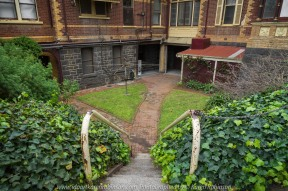 """Elsternwick, Victoria - Australia_Photographed by ©Karen Robinson_ www.idoartkarenrobinson.com September 10, 2017 Comments: My hubby and I with the Craigieburn Camera Club at Rippon Lea House and Gardens. """"It is one of Australia's finest grand suburban estates and the first to achieve National Heritage Listing, recognising its unique significance. The historic mansion is located within a vast pleasure garden of sweeping lawns that cover more than 14 acres and features a windmill, lookout tower, heritage orchard, lake, waterfall, fernery and more!"""" Photograph featuring staircase leading to the entrance to the Mansions original kitchens."""