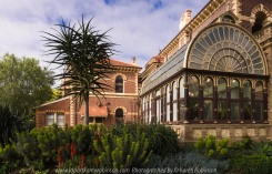 "Elsternwick, Victoria - Australia_Photographed by ©Karen Robinson_ www.idoartkarenrobinson.com_September 10, 2017 Comments: My hubby and I with the Craigieburn Camera Club at Rippon Lea House and Gardens. ""It is one of Australia's finest grand suburban estates and the first to achieve National Heritage Listing, recognising its unique significance. The historic mansion is located within a vast pleasure garden of sweeping lawns that cover more than 14 acres and features a windmill, lookout tower, heritage orchard, lake, waterfall, fernery and more!"" Photograph featuring Conservatory at side of the Mansion's front entrance."