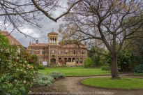 """Elsternwick, Victoria - Australia_Photographed by ©Karen Robinson_ www.idoartkarenrobinson.com_September 10, 2017 Comments: My hubby and I with the Craigieburn Camera Club at Rippon Lea House and Gardens. """"It is one of Australia's finest grand suburban estates and the first to achieve National Heritage Listing, recognising its unique significance. The historic mansion is located within a vast pleasure garden of sweeping lawns that cover more than 14 acres and features a windmill, lookout tower, heritage orchard, lake, waterfall, fernery and more!"""" Photograph featuring backside of Mansion with a circular drive way in foreground."""