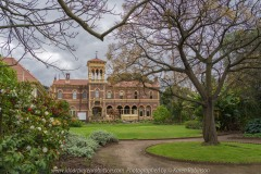 "Elsternwick, Victoria - Australia_Photographed by ©Karen Robinson_ www.idoartkarenrobinson.com_September 10, 2017 Comments: My hubby and I with the Craigieburn Camera Club at Rippon Lea House and Gardens. ""It is one of Australia's finest grand suburban estates and the first to achieve National Heritage Listing, recognising its unique significance. The historic mansion is located within a vast pleasure garden of sweeping lawns that cover more than 14 acres and features a windmill, lookout tower, heritage orchard, lake, waterfall, fernery and more!"" Photograph featuring backside of Mansion with a circular drive way in foreground."