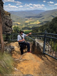 Whitlands, Victoria - Australia 'Powers Lookout' Photographed by Karen Robinson Dec 2017 www.idoartkarenrobinson.com NB. All images are protected by copyright laws. Comments: Here we had the opportunity to experience incredible views across the King River Valley. Featured here my hubby carrying photography equipment for me, up and down the steep stairs around Powers Outlook.Outlook.
