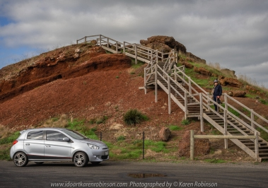 Alvie, Victoria - Australia 'Red Rock' Photographed by Karen Robinson May 2018 NB. All images are protected by copyright laws. Comments – Hubby and I stopped at Red Rock during one of our photography adventures. It wasn't planned, but thankfully we did take the opportunity to divert from our journey to Warrnambool. We experienced magnificent 360-degree views from atop of Red Rock! Spectacular complex volcanic sites formed by eruptions some 10's of thousands of years ago, with the last eruption 800 years ago, can be sighted across the surrounding topography of volcanic plain and the 25,000-hectare Lake Corangamite. We spent some time here taking photographs and just enjoying the breathtaking views from every angle - on a glorious Autumn day.