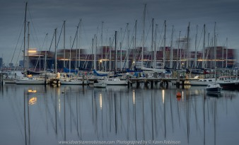 Williamstown, Victoria - Australia 'Early morning at Ferguson Street Pier looking out across Port Phillip Bay' Photographed by Karen Robinson July 2019 Comments - Cold winter's morning catching the sun rising - Cargo Ship passing by behind docked yachts.