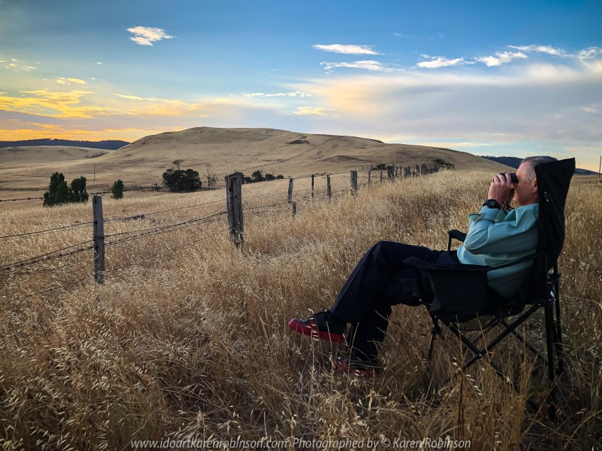 High Camp, Victoria - Australia 'Granite Boulder Region' Photographed by Karen Robinson December 2019 Comments: Beautiful early morning around sunrise in an area that features many giant granite boulders. Photograph featuring hubby looking at the landscape through binoculars.