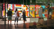 Melbourne, Victoria - Australia 'Summer morning corner of Elizabeth Street and Flinders Lane' Photographed by ©Karen Robinson Jan 2021 Comments: Comments: Decided to do some street photography for a change. Managed to photograph one of Melbourne's colourful trams passing by people waiting to cross Elizabeth Street. Because of COVID-19 there was a great reduction of the number of people when compared to past years. Mask wearing being a sign of the times!