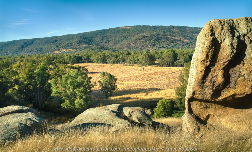 Trawool, Victoria - Australia 'Greenslopes Road' Photographed by Karen Robinson Jan 2021 Comments: A lovely drive along Greenslopes Road reveals summer grasslands, granite boulders, hills and mountain ranges, waterholes with actual water still in them and glimpses of the Goulburn River.