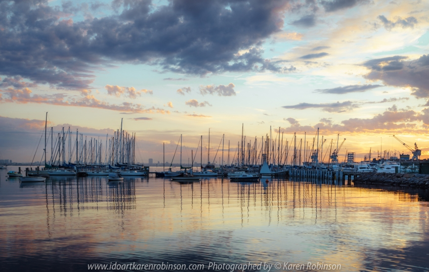 Williamstown, Victoria - Australia 'Sunrise New Year's Day 2021' Photographed by Karen Robinson Jan 2021 Comments: Beautiful sunrise at Williamstown from Bay Trail Walk looking across Port Phillip Bay towards anchored Yachts and Boats and Melbourne City Skyline.