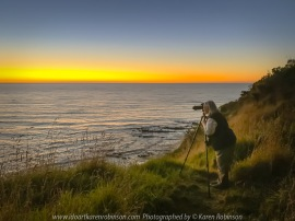 Eastern View, Victoria - Australia 'Devil's Elbow at Sunrise' Photographed by Karen Robinson February 2021 Comments: Beautiful mild summer morning overlooking the ocean along Lorne-Queenscliff Coastal Reserve, just off the Great Ocean Road. View, Victoria - Australia 'Devil's Elbow at Sunrise' Photographed by Karen Robinson February 2021 Comments: Beautiful mild summer morning overlooking the ocean along Lorne-Queenscliff Coastal Reserve, just off the Great Ocean Road. Photograph featuring Karen Robinson photographing sunrise.