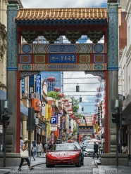Melbourne, Victoria - Australia 'Little Bourke Street' Photographed by Karen Robinson Jan 2021 Comments: Decided to venture into the City of Melbourne - Chinatown on Little Bourke Street to do some Street/Documentary Style Photography. Photograph featuring a woman carrying a bag over her shoulder walking across at the lights in front of the red car under Chinatown's arches.