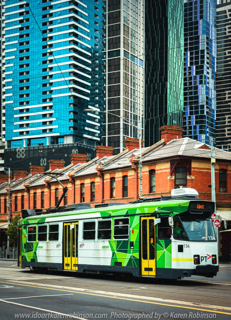 West Melbourne, Victoria - Australia 'Victoria Street - Queen Victoria Market' Photographed by Karen Robinson February 2021 Comments: Out-and-about doing some more Street/Documentary Photography. In this image, I managed to capture patterned, beautifully coloured skyscrapers behind a line of Queen Victoria Market orange brick buildings with one of Melbourne's Trams travelling through the scene in the foreground. Great contrasts of colour and patterns!